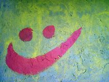 Happy smile painted on old wall Stock Photography