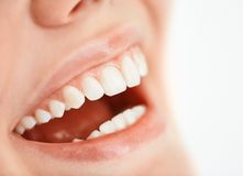 Happy smile. Toothy smile of a young woman Stock Image