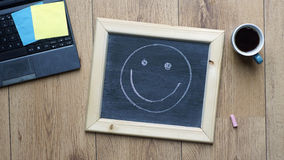 Happy. smile  written at the office Royalty Free Stock Images