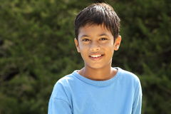 Happy smile from young boy in countryside sunshine Royalty Free Stock Photo