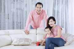 Happy smiles Asian family on the couch Stock Photography