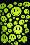 Happy smiles over black background Royalty Free Stock Photography