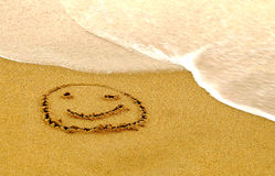 Happy Smiley on a Beach Stock Photo