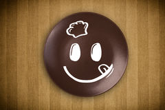 Happy smiley cartoon face on colorful dish plate Stock Images