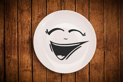 Happy smiley cartoon face on colorful dish plate Royalty Free Stock Photos
