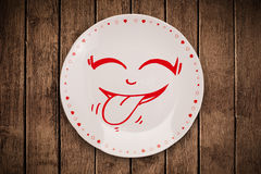 Happy smiley cartoon face on colorful dish plate Stock Image