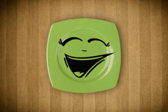 Happy smiley cartoon face on colorful dish plate Stock Photo