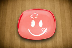 Happy smiley cartoon face on colorful dish plate Royalty Free Stock Image