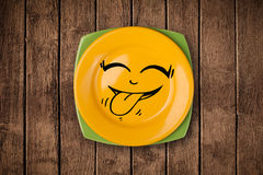 Happy smiley cartoon face on colorful dish plate Stock Photography