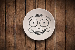Happy smiley cartoon face on colorful dish plate Royalty Free Stock Images