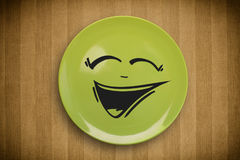 Happy smiley cartoon face on colorful dish plate Stock Photos