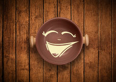 Happy smiley cartoon face on colorful dish plate Royalty Free Stock Photography