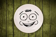Happy smiley cartoon face on colorful dish plate Royalty Free Stock Photo