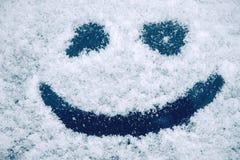 Happy smiley emoticon face in snow Royalty Free Stock Photos