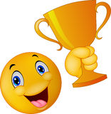 Happy smiley emoticon holding trophy Royalty Free Stock Photos