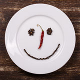 Happy smiley face on dish plate Royalty Free Stock Image