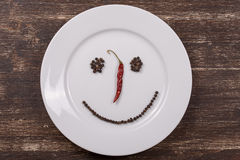 Happy smiley face on dish plate Stock Photos