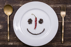 Happy smiley face on dish plate Stock Images