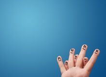 Happy smiley face fingers looking at empty blue background copy Royalty Free Stock Photography