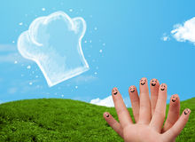 Happy smiley face fingers looking at illustration of cook hat Stock Photo