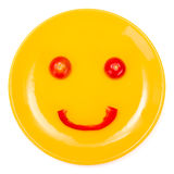Happy smiley face made on plate Royalty Free Stock Images