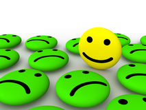 Happy smiley face among sad smileys. 3d rendering Stock Photos
