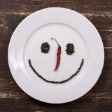 Happy smiley face on white plate Stock Images
