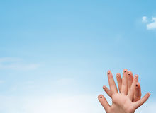 Happy smiley fingers looking at clear blue sky copyspace Royalty Free Stock Photos