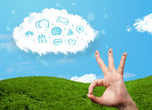 Happy smiley fingers looking at cloud with blue social icons and. Happy cheerful smiley fingers looking at cloud with blue social icons and smybols stock images