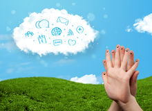 Happy smiley fingers looking at cloud with blue social icons and. Happy cheerful smiley fingers looking at cloud with blue social icons and smybols Stock Photography