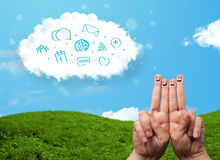 Happy smiley fingers looking at cloud with blue social icons and. Happy cheerful smiley fingers looking at cloud with blue social icons and smybols royalty free stock images