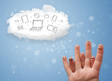 Happy smiley fingers looking at cloud computing with technology. Happy cheerful smiley fingers looking at cloud computing with technology icons royalty free stock photo