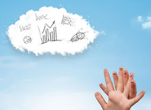 Happy smiley fingers looking at cloud with hand drawn charts Royalty Free Stock Photo