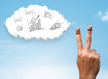 Happy smiley fingers looking at cloud with hand drawn charts Royalty Free Stock Image