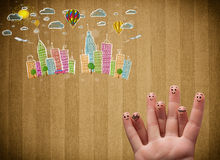Happy smiley fingers looking at colorful handrawn cityscape. Happy cheerful smiley fingers looking at colorful handrawn cityscape Stock Photo