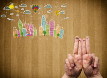 Happy smiley fingers looking at colorful handrawn cityscape. Happy cheerful smiley fingers looking at colorful handrawn cityscape Stock Images