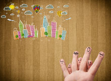 Happy smiley fingers looking at colorful handrawn cityscape. Happy cheerful smiley fingers looking at colorful handrawn cityscape Royalty Free Stock Photo