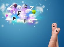 Happy smiley fingers looking at colorful magical clouds and ball Stock Photos