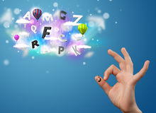 Happy smiley fingers looking at colorful magical clouds and ball. Happy cheerful smiley fingers looking at colorful magical clouds and balloons illustration Stock Photo