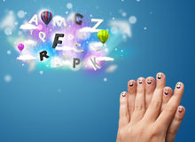 Happy smiley fingers looking at colorful magical clouds and ball Royalty Free Stock Photography