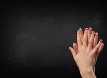 Happy smiley fingers looking at empty black chalboard Royalty Free Stock Images