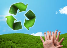 Happy smiley fingers looking at green leaf recycle sign Royalty Free Stock Images
