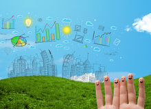 Happy smiley fingers looking at hand drawn urban city landscape. Happy cheerful smiley fingers looking at hand drawn urban city landscape Royalty Free Stock Photos