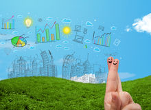 Happy smiley fingers looking at hand drawn urban city landscape Royalty Free Stock Photo