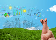 Happy smiley fingers looking at hand drawn urban city landscape Stock Images