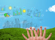 Happy smiley fingers looking at hand drawn urban city landscape Stock Photo