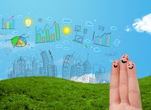 Happy smiley fingers looking at hand drawn urban city landscape. Happy cheerful smiley fingers looking at hand drawn urban city landscape Stock Photos