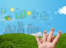 Happy smiley fingers looking at hand drawn urban city landscape. Happy cheerful smiley fingers looking at hand drawn urban city landscape stock photo