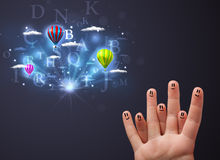 Happy smiley fingers looking at hot air balloons in the cloudy s Stock Images