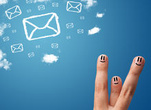 Happy smiley fingers looking at mail icons made out of clouds. Happy cheerful smiley fingers looking at mail icons made out of clouds Royalty Free Stock Photography